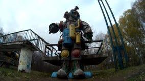 Giant mechanical astronaut robot moving head in the park. Ukraine Khmelnytskyi stock video