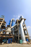 Giant mechanical facilities in a cement factory Stock Photos