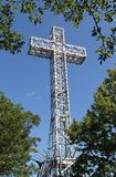 Giant Metal White Cross Against Blue Sky Royalty Free Stock Photos