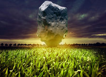 Giant meteorite. Over the night corn field. 3d rendering and photo elements illustration Royalty Free Stock Photos