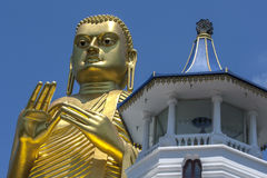 The giant 30 metre high golden statue of Buddha at the Golden Temple in Dambulla in Sri Lanka. Royalty Free Stock Photos
