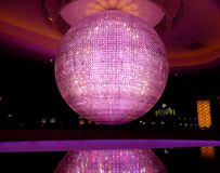 Giant mirror ball. With Purple light and reflection Stock Image