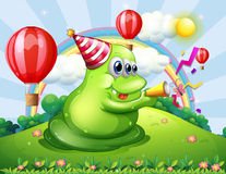 A giant monster at the hilltop with a party hat Royalty Free Stock Images