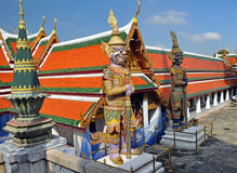 Giant Mosaic Figures Guard the Grand Palace stock photo