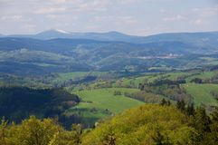 Giant mountains from,Jestrebi mountains, Czech republic. Giant mountains from lookout tower on the Markousovicky ridge,Jestrebi mountains, Eastern Bohemia, Czech Royalty Free Stock Photography