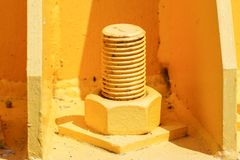 Giant nut and bolt on base plate of metal pole royalty free stock images