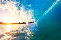A Giant ocean wave tube. Big Ocean Wave at Sunrise Stock Photo