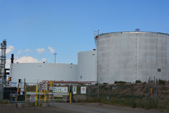 Giant Oil Storage Tanks. Large oil storage containers adjacent to a refinery Royalty Free Stock Photography