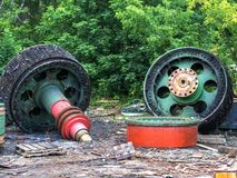 Giant old spare parts of scrap metal. Clogging of the environment. Danger for the future generation Stock Photos