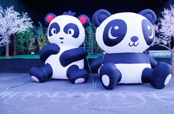 Giant panda balloons at the night market Royalty Free Stock Photos
