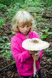Giant parasol mushroom. Girl with giant parasol mushroom at autumn time Stock Photography