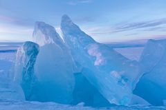 Giant pieces of blue ice on Lake Baikal at sunset stock images