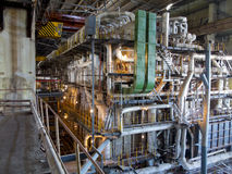 Giant pipes, tubes and equipment inside power plant, night scene Royalty Free Stock Photography