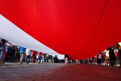 Giant Polish flag on a demonstration in Warsaw, Poland stock photo