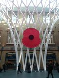 Giant poppy at kings cross station london Royalty Free Stock Photos