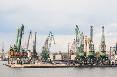 Giant port cranes at cargo terminal Royalty Free Stock Photos