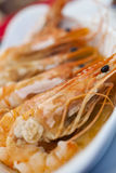Giant Prawns or Shrimp Grilled in Garlic Butter Stock Photos