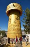 Giant prayer wheel at Tibetan Buddhist temple. SHANGRI-LA, YUNNAN, CHINA - OCTOBER 17, 2017: Giant prayer wheel at Tibetan Buddhist temple Dafo temple in Shangri Royalty Free Stock Images