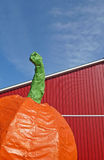 Giant pumpkin red barn blue sky Royalty Free Stock Photo