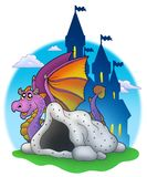 Giant purple dragon near cave stock images