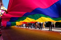 Giant Rainbow Flag in a Pride Parade royalty free stock image