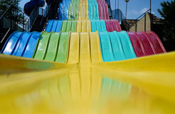 Giant Rainbow Slide. A giant colorful rainbow slide royalty free stock photos