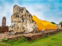 Giant Reclining Buddha statue in the historical Park Ayutthaya. Giant Reclining Buddha statue in the historical Park of Ayutthaya, Thailand, Pra non Royalty Free Stock Photo