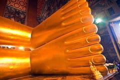 The giant Reclining Buddha in Wat Stock Photo