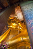 Giant reclining Buddha at Wat Pho. Wat Pho is one of famous temple in The Kingdom of Thailand. The main icon of this temple is its giant reclining Buddha Stock Photography