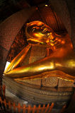 Giant Reclining buddha within the Wat Pho in Bangk Royalty Free Stock Images