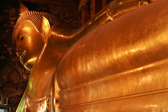 Giant Reclining buddha within the Wat Pho in Bangk Royalty Free Stock Photography