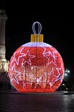 Giant Red Xmas Ball with White Stars. Christmas giant ball with red lights and white stars in Rossio, Lisbon historic downtown area Royalty Free Stock Image