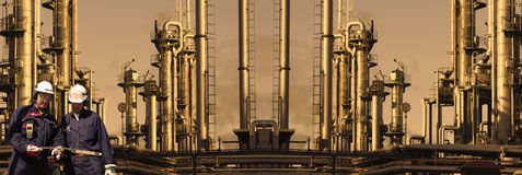 Giant refinery with workers, panoramic view Royalty Free Stock Photography