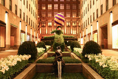 Giant revolving Easter Bunny topiary displayed at Rockefeller Center Channel Gardens at night Stock Photos