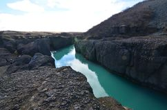 Huge river going through large rock formations in Iceland royalty free stock images