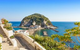 Giant rock near small village Sant`Angelo on Ischia island, Ital Royalty Free Stock Photos
