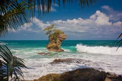 Picturesque view of ocean in Manzanillo on Costarican coast. Giant rock in ocean near by Costarican coast, the best vacation, travel holiday in paradise, travel stock photos