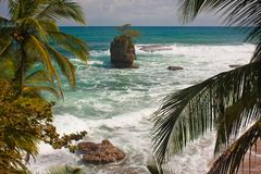 Giant rock in ocean near by Costarican coast. The best vacation, travel holiday in paradise, travel the world adventure royalty free stock photography