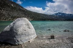Free Giant Rock On The Shore Of June Lake In California In The Sierra Nevada Mountains Royalty Free Stock Photography - 138870407