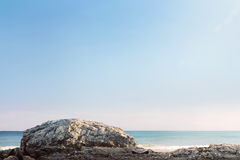 Giant rock and sea waves with blue sky Stock Image