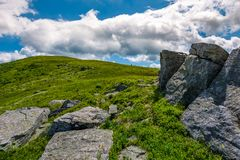 Giant rocks on a hill in summertime. Beautiful landscape under the blue sky with some clouds stock image
