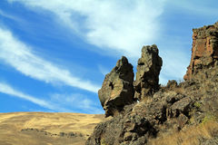 Giant Rocks on a Hillside Overlooking a Valley Stock Photo