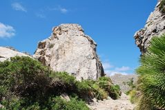 Boquer valley in Majorca. Giant rocks line the trail through the Boquer valley in the Serra de Tramuntana mountains on the Spanish island of Majorca. Starting in royalty free stock photos