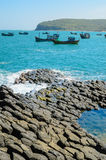 Giant's basalt Causeway with fishing boats, Phu Yen Royalty Free Stock Photos