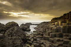 Giant's Causeway along the Northern Ireland coast. According to legend, the interlocking basalt columns are the remains of a causeway built by legendary giant stock photos