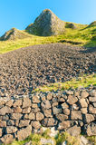 Giant s Causeway. The Giant`s Causeway is an area of approximately 38000 columns, the result of acient volcanic activity 60 million years ago. It was declared a stock image