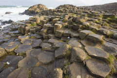 Giant`s causeway. Hexagon-shaped basalt rocks at Giant`s Causeway in Northern Ireland royalty free stock photography