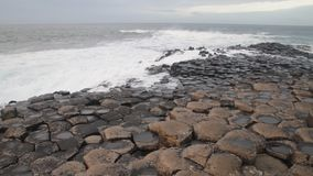 The Giant`s Causeway wind and waves. The Giant`s Causeway, made up of 40,000 interlocking basalt columns, the result of an ancient volcanic eruption in Bushmills stock video footage
