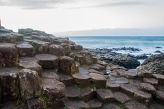 The Giant`s Causeway. Made up of 40,000 interlocking basalt columns, the result of an ancient volcanic eruption in Bushmills, County Antrim, Northern Ireland stock photo