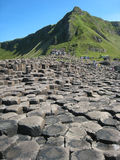 Giant 's causeway. Northern Ireland. People rambling around the basaltic formations in the Giant 's causeway. Northern Ireland Stock Image